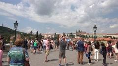 ULTRA HD 4K Busy pedestrian people Charles Bridge Prague landmark tourist people Stock Footage