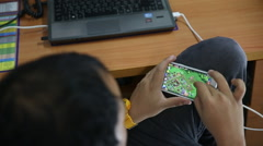 Young happy man playing games on smartphone, video hd Stock Footage