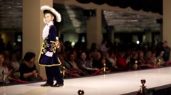 Stock Video Footage of Little boy model walks the runway during Estet fashion week
