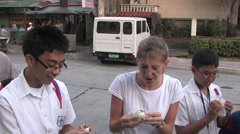 Eating Balut in Downtown Manilla, Philippines Stock Footage