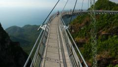 European tourist couple on aerial curved bridge, observation deck, Langkawi Stock Footage