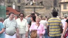 ULTRA HD 4K Closeup tourist people commute old town Prague city crowded sidewalk Stock Footage
