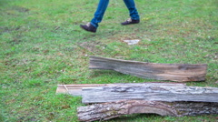 A man walking through the residues tree trunk - stock footage