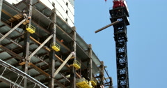 Stock Video Footage of 4k Construction Crane lowering I-Beam
