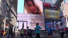 Runners down Seventh Avenue Stock Footage