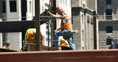 4K Construction workers Securing Hoisting I-Beam Real Estate Part 2 Stock Footage