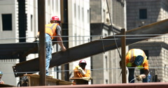 4K Construction workers Securing I-Beam Real Estate Part 1 Stock Footage