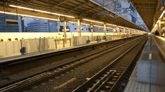 Japanese Bullet Train Arriving at Tokyo Station Platform Stock Footage