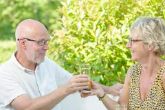 A middle-aged couples drinks Stock Photos