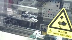 Robotic machine doing motherboard Stock Footage