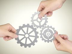 Stock Photo of cooperation concept: hands holding gears