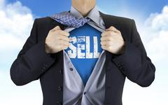 Businessman showing Sell word underneath his shirt Stock Photos