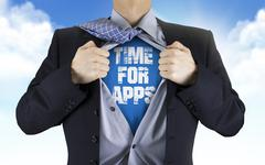 Businessman showing Time for apps words underneath his shirt Stock Photos
