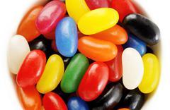 multi colour jelly beans on white - stock photo
