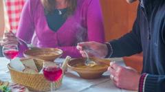 Couple eat a tripe in domestic inn Stock Footage