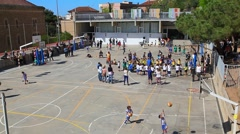 Kids playing at school playground during the break in Barcelona, Spain Stock Footage