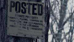 Posted Private Property | Hunting, Fishing Prohibited Sign in Woods Stock Footage