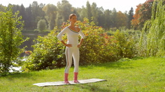 Young slim pretty woman doing fitness exercises for hips, spine and lower back Stock Footage