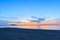 Sunrise on the beach and beautiful sky - stock photo
