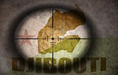 Sniper scope aimed at the vintage djibouti flag and map Stock Illustration
