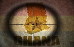 Stock Illustration of sniper scope aimed at the vintage ghanaian flag and map
