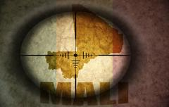 Sniper scope aimed at the vintage malian flag and map Stock Illustration