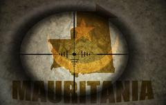 sniper scope aimed at the vintage mauritania flag and map - stock illustration
