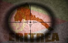 Sniper scope aimed at the vintage eritrean flag and map Stock Illustration