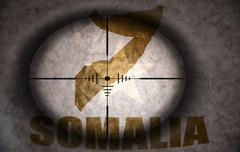 Sniper scope aimed at the vintage somalia flag and map Stock Illustration