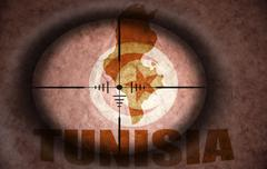 Stock Illustration of sniper scope aimed at the vintage tunisian flag and map