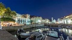 Hvar harbor in the centre of the old city of Hvar by night Stock Footage