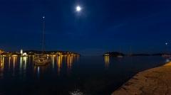Moon lighted harbor on Hvar island in Hvar city Stock Footage