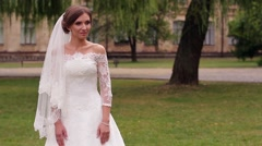 Stock Video Footage of Bride in  white dress makes a decision.