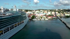 Antigua Caribbean Sea 200 leaving St. John's harbor with a big cruise ship Stock Footage