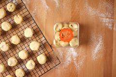 Auspicious gift exchange using cookies Stock Photos