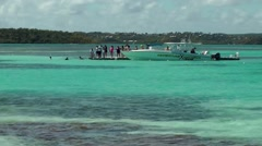 Antigua Caribbean Sea 161 boat with tourists arrived at Stingray sandbank Stock Footage