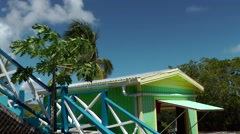 Antigua Caribbean Sea 163 very colorful Caribbean mood with a wooden hut Stock Footage