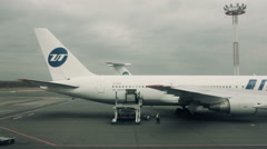 Airliner on airport airfield. Cargo loading. Stock Footage