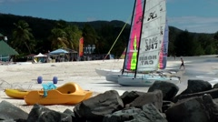 Stock Video Footage of Antigua Caribbean Sea 175 Jolly Beach colorful sailing boats on the sand