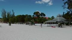 Antigua Caribbean Sea 176 Jolly Beach restaurant pavilion on snow white sand Stock Footage
