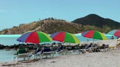Antigua Caribbean Sea 177 Jolly Beach colorful sunshades at waterfront Stock Footage