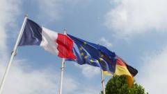 Wind over French, German and European Union Flag Stock Footage