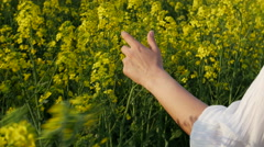 Girl running happy in Brassica rapa canola field - stock footage