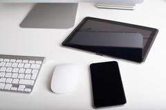 Wireless keyboard, mouse, tablet and smartphone - stock photo