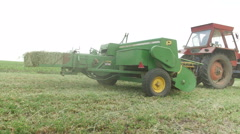Stock Video Footage of harvesting and baling alfalfa or Lucerne with tractor