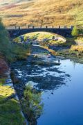 Afon Claerwen with Bridge. Tranquil river in welsh countryside. - stock photo