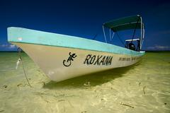 close up of a boat in the blue laggon sian kaan - stock photo