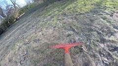 POV rake leaves and old dry grass with rake tool. 4K Stock Footage