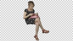Sitting little girl reads the book. Footage with transparent background. Stock Footage