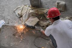 Chinese Construction Worker Cutting Metal Rebar Stock Photos